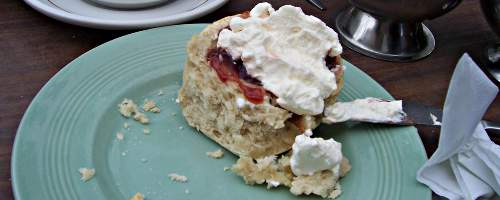 A scone with cream and jam